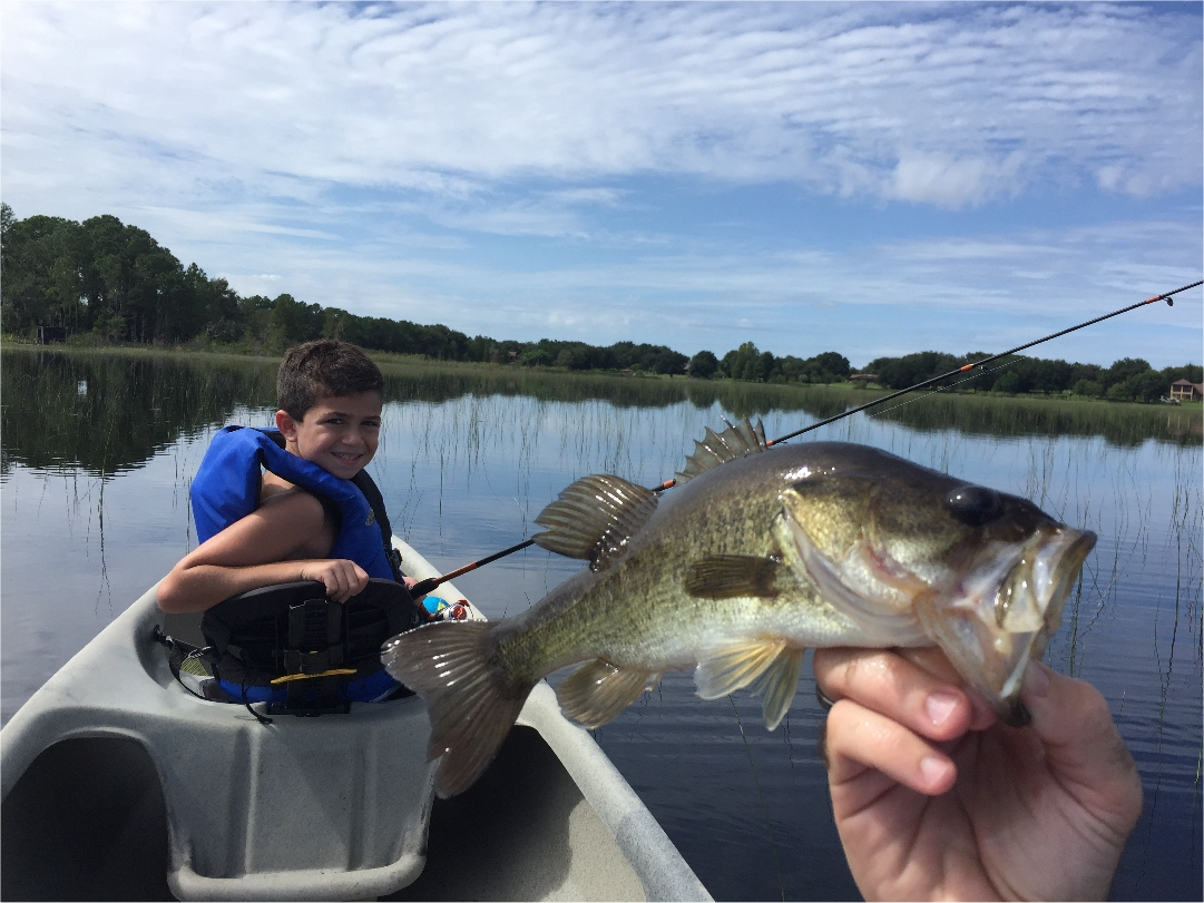 fishing on this Florida lake at The Great Escape vacation rental