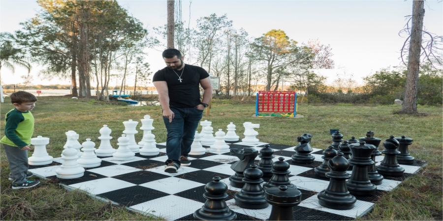 Giant Chess Board outdoors at The Great Escape Lakeside Vacation Rental Home near Orlando, Florida and Walt Disney World